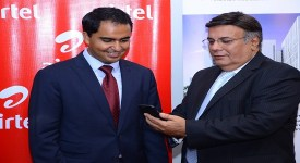 Medanta Africare President & CEO Anil K. Maini demonstrates to Airtel Kenya CEO Adil El Youssefi on how to access mHealth services through the short code- 1525 on Airtel network.-min