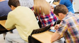 student texting in class