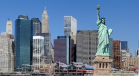 The landmark Statue of Liberty against the impressive New York City skyline.