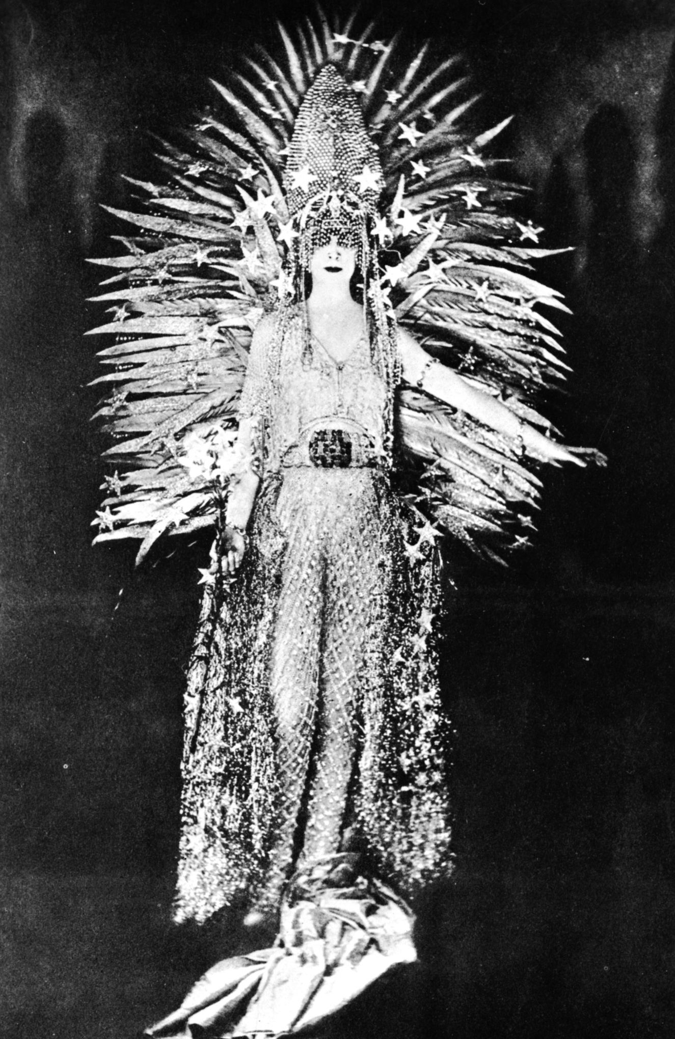 Marchesa Luisa Casati wearing a costume symbolising light to a fancy dress party in Paris, 1922. The costume, designed by Worth, is made of a net of diamonds, i