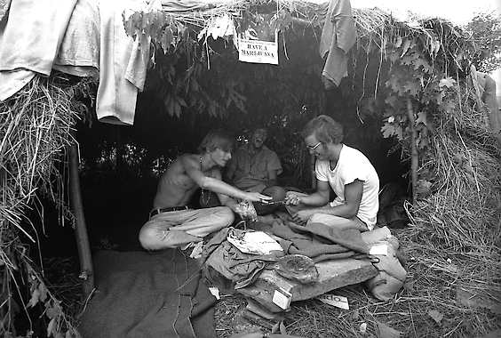 17, 1969, photo at the Woodstock Music and Art Festival in Bethel, N.Y., music fans take shelter in a grass hut at the festival.