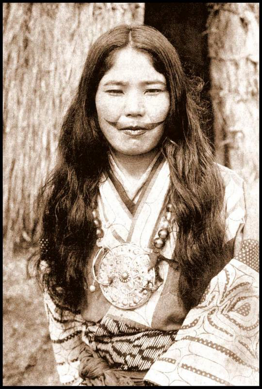ROB OECHSLE COLLECTION An Ainu woman with a face tattoo poses for a photo in Hokkaido circa 1910