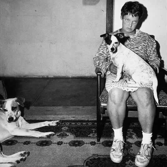 Roger Ballen Woman-and-dogs-Orange-Free-State-1994