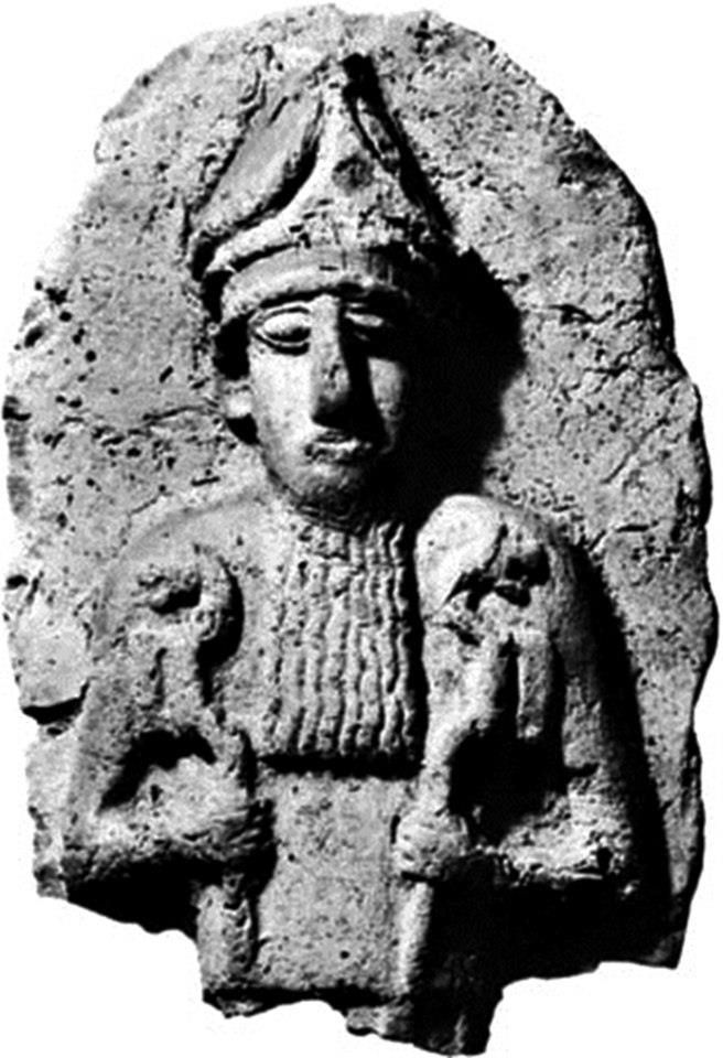 Nergal - Mesopotamian god of the underworld - holding his lion headed staffs - Terra-cotta relief found Kish, c. 2.100-1.800 BCE