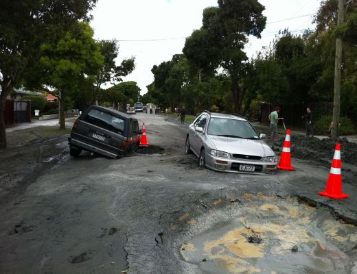 Two cars stuck in sink holes on Flemington Avenue