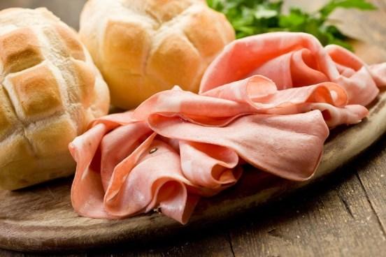 Mortadella with Bread on Chopping board