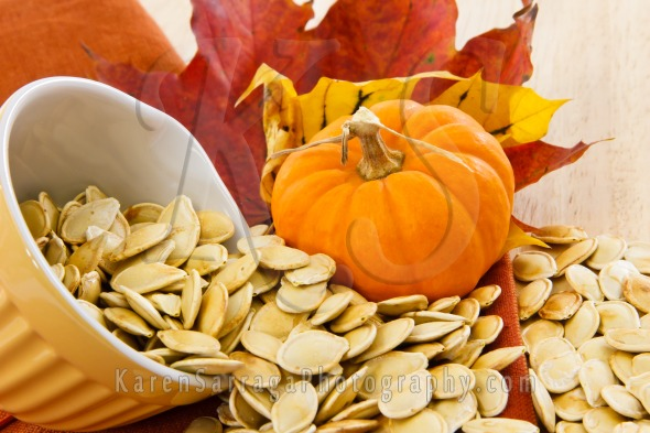 Royalty Free Content: Toasted Pumpkin Seeds Spilling From A Yellow Bowl