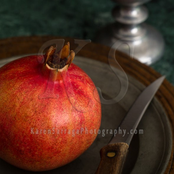 Royalty Free Content: Red Pomegranate On A Pewter Plate