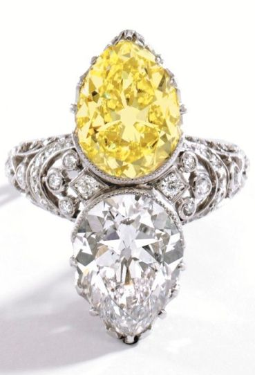 An Edwardian Platinum, Diamond and Fancy Intense Yellow Diamond Ring, Tiffany & Co