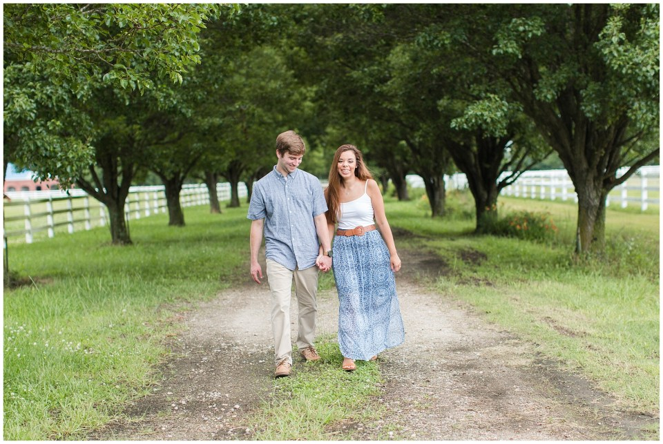 couple walking between the trees at back bay farms