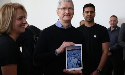 "Apple CEO Tim Cook holds the new 9.7"" iPad Pro during an Apple special event at the Apple headquarters on March 21, 2016 in Cupertino, California."