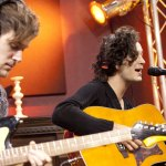 Adam Hann and Matthew Healy performing
