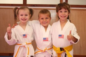 Kinder Karate students pose after class. Image courtesy of Kinder Karate.