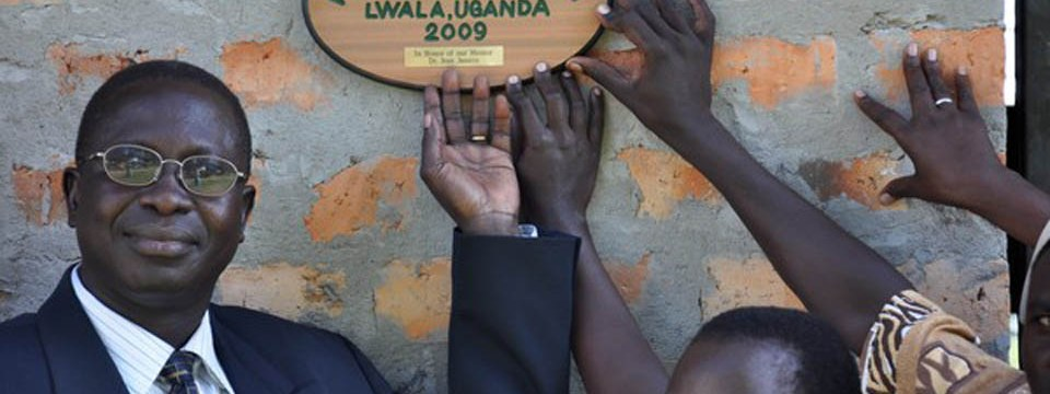 A plaque honoring Dr. Jean Jannin, KFWH founding mentor, is placed outside the KFWH pediatric clinic at the Lwala Hospital in Lwala, Uganda.