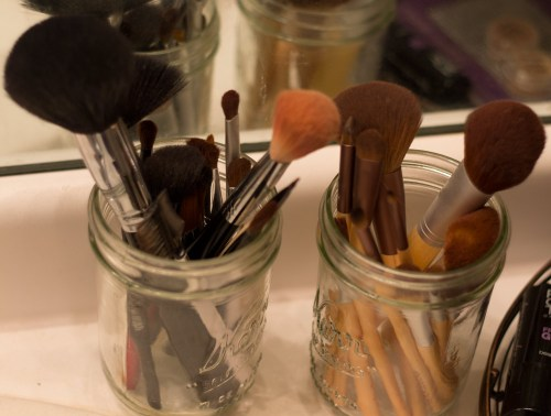 makeup brushes in mason jars