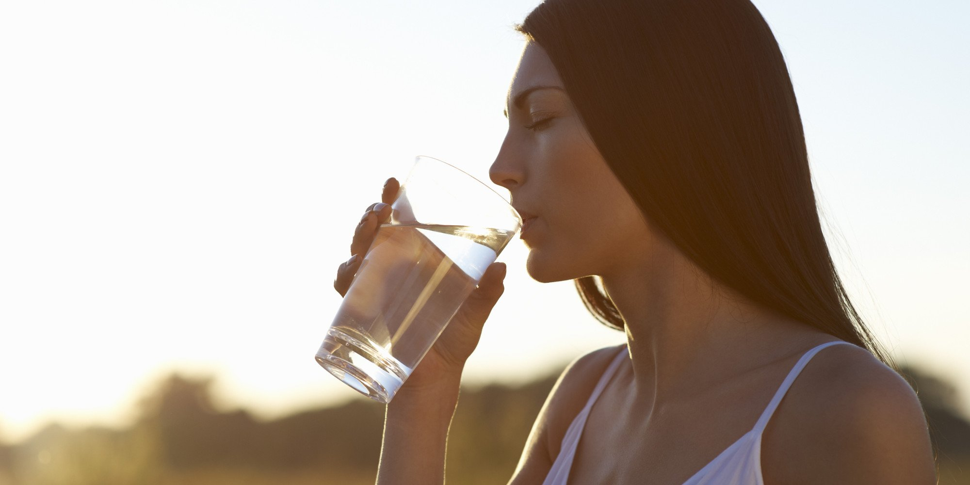 Profile of woman drinking water on hot Summers day
