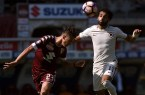 TURIN, ITALY - SEPTEMBER 25:  Antonio Barreca (L) of Torino and Mohamed Salah of Roma compete for the ball during the Serie A match between FC Torino and AS Roma at Stadio Olimpico di Torino on September 25, 2016 in Turin, Italy.  (Photo by Tullio M. Puglia/Getty Images)