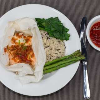 Fish Parcels with wild rice, spinach and asparagus