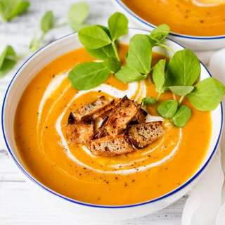 Baked sweet potato and carrot soup with cheddar potato skin croutons