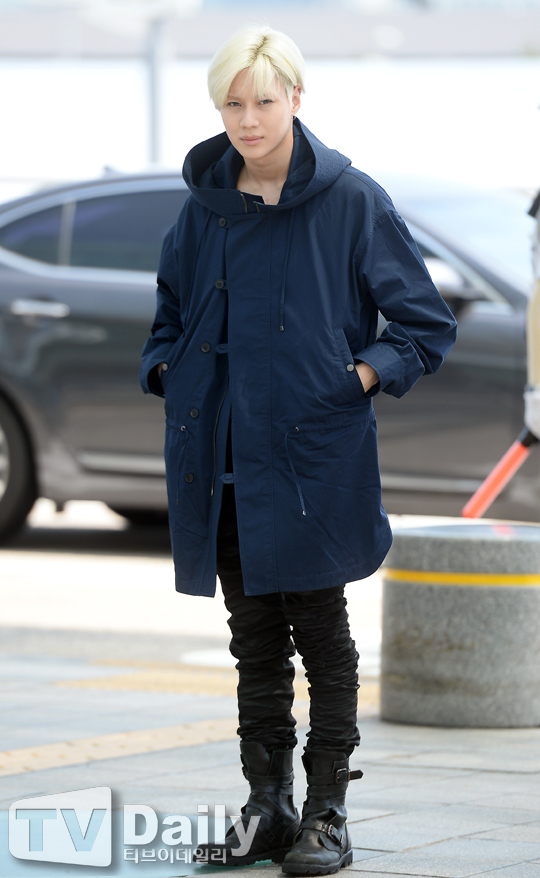 Image: Taemin heading within the Incheon Foreign Airport from the departure spaceto visit Milan / Television Daily