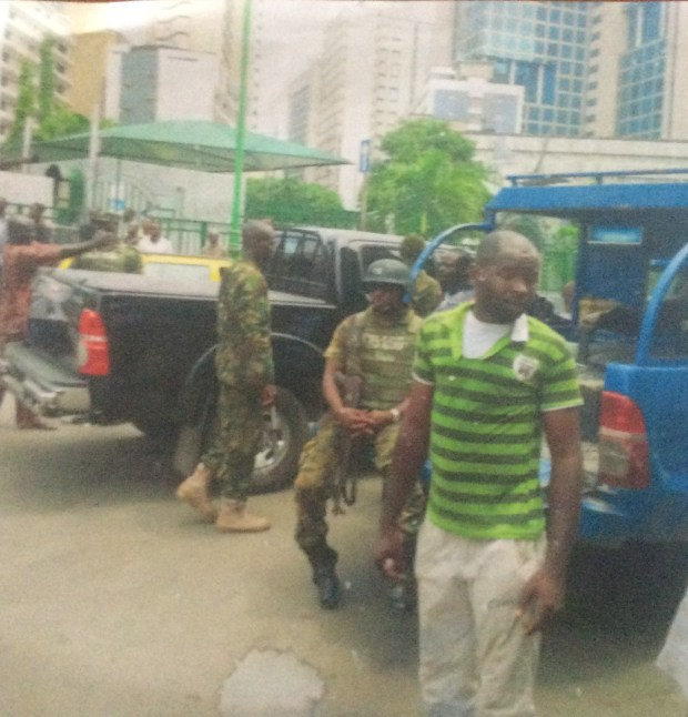 One of the earlier attempts at demolishing the building was captured by a passerby. The soldiers seen here had come to protect those intending to demolish the building. They were repelled in the end by a crowd of concerned residents led by Eric Awóbuyìdé and eventually the Nigerian Police. Photo source: Eric Awóbuyìdé.