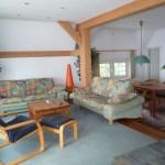 Die Sitzecke des Wohnbereichs kann des Nachts einfach zum Doppelbett umgerüstet werden.