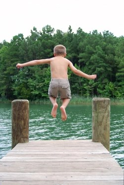 boy-jumping-dock