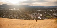 Individual hiker works her way up a hill overlooking Missoula, Montana in the United States.