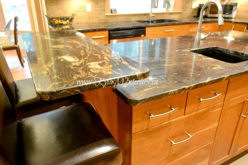 Kitchen countertop raised island bar with black and gold granite and