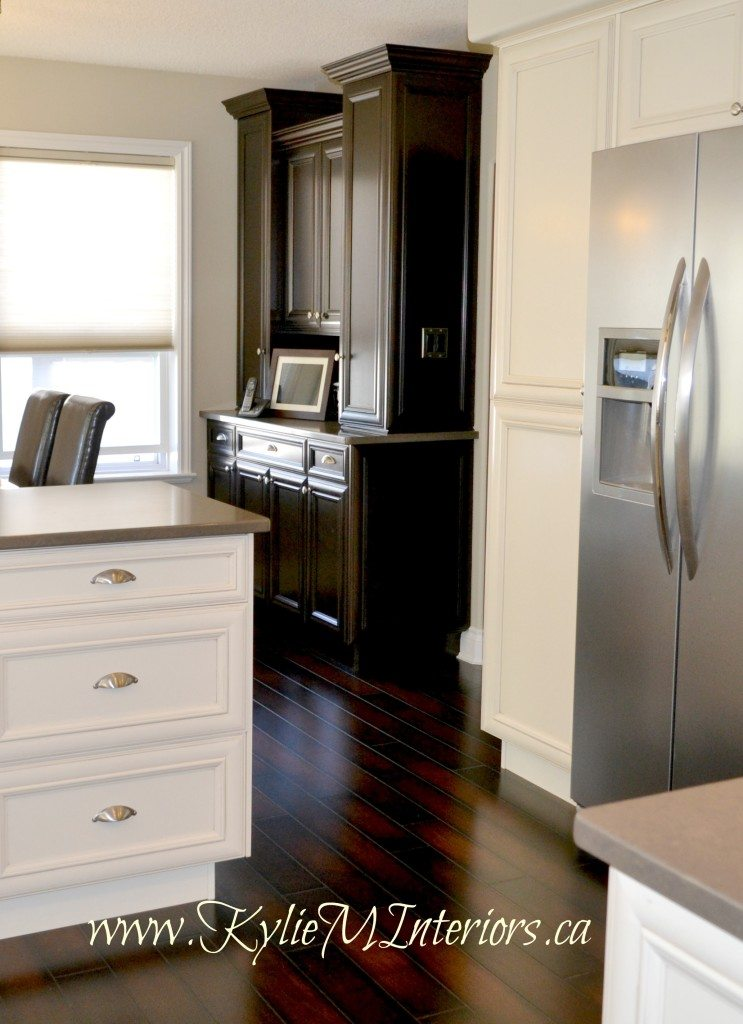 different colour of cabinets cream and dark wood with dark wood floors