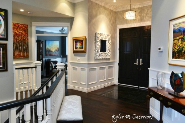 light gray grey with dark wood floors stonington gray best for entryway with white wainscoting and black interior front door and original artwork benjamin moore