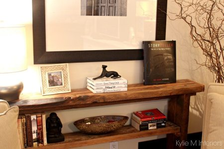 ideas to personalize a home with home decor books and accessories. shown in living room on live edge sofa or console table 1024x689