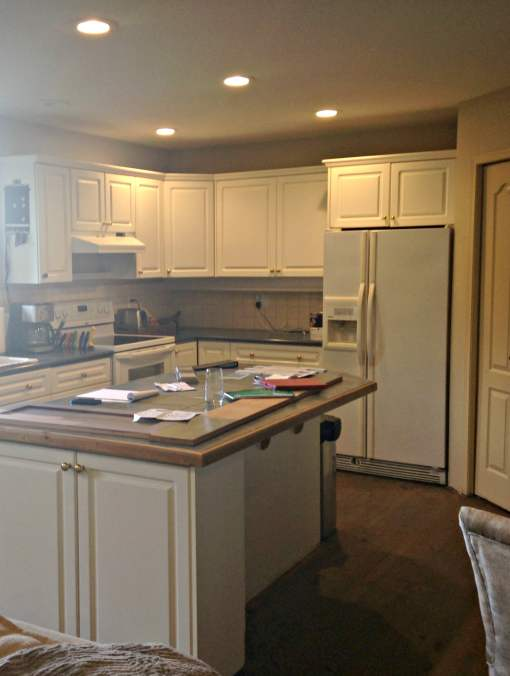... thermofoil cabinets, white appliances and a tiled island countertop