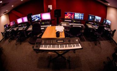 "This advanced Pro Tools lab is where students complete their 201 and 210M coursework within the Avid Pro Tools Certified Operator curriculum. The lab features Apple Mac Pro workstations with dual 24"" LCD screens running Avid Pro Tools HD systems, M-Audio Axiom 49 MIDI controllers and the Command 8 control surface. The benefits of Pro Tools HD are further explored by integrating outboard effects processors by Lexicon and TC Electronics as well as Yamaha Motif ES synthesizers."