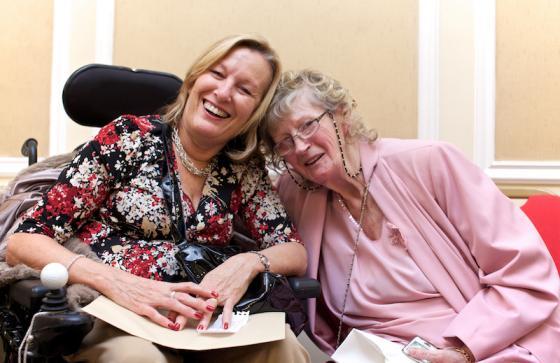 Happy patient using wheelchair