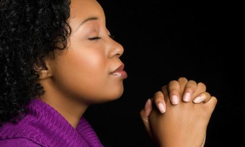 black-woman-purple-jumper-praying