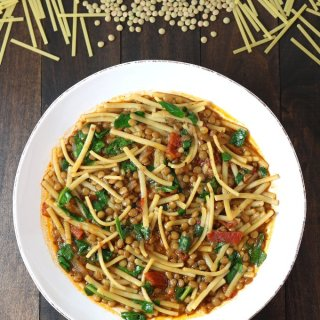 Lentils, noodles, carmelized onions, tomatoes, and a spiced broth come together to make this filling Lentil and Spinach Rashteh.