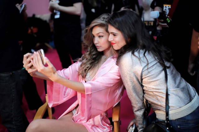 Model Gigi Hadid makes a selfie as she gets ready backstage before the Victoria's Secret Fashion Show at the Grand Palais in Paris, France, November 30, 2016. REUTERS/Benoit TessierFOR EDITORIAL USE ONLY. NOT FOR SALE FOR MARKETING OR ADVERTISING CAMPAIGNS