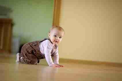 Adorable crawling baby girl