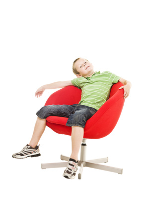 Young boy in armchair