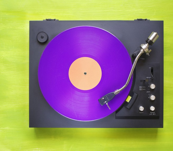 Retro turntable with purple vinyl record, free copy space