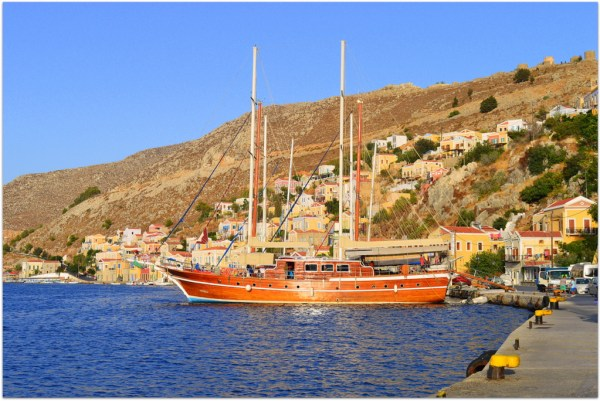 Symi Muhtesem at harbour with scenery