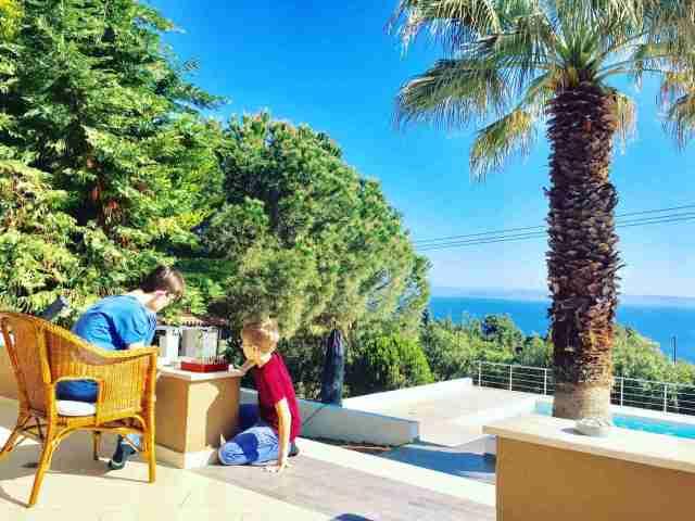 villa anna maria eddie and harry playing chess