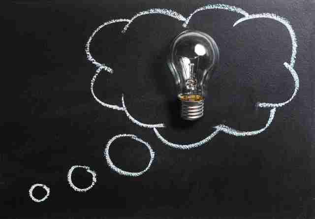 idea lightbulb in chalk cloud