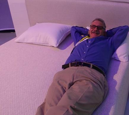 Larry sleeps on the job on a Sleep Number smart bed