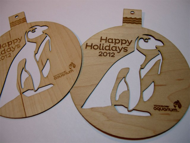 Detail of Custom laser cut wood Christmas tree ornaments for the Vancouver Aquarium