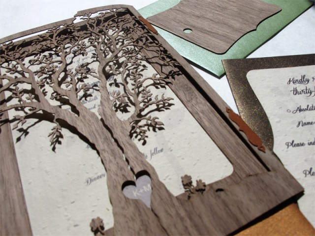 Walnut wood laser cut 'Love Tree' wedding invites featuring heart cutout