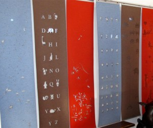 Laser cut merino wool felt window coverings for kids rooms, 6 wall hangings side by side mounted on sliding tracks