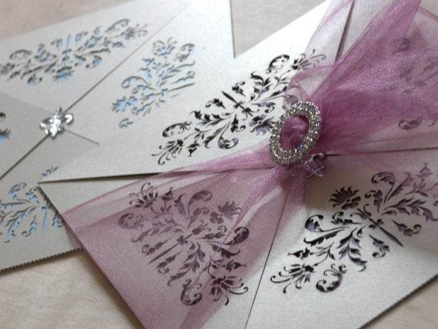 Couture invitations feature a delicate laser cut French pattern - purple