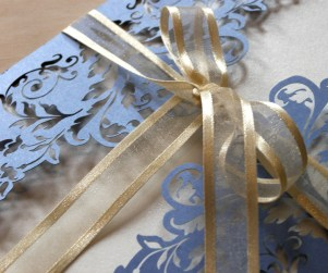 detail of Periwinkle Blue French Flair laser cut wedding invitations